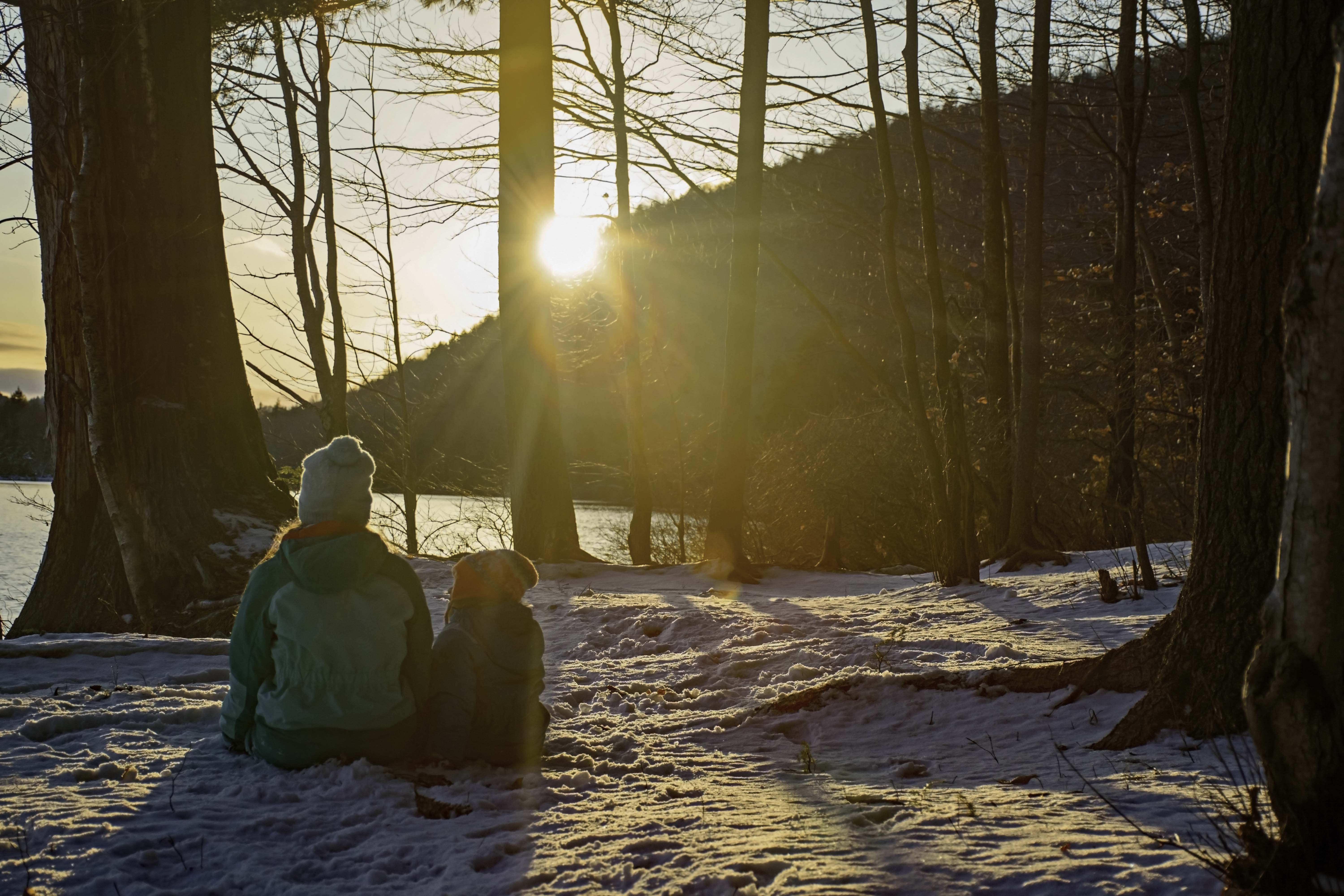 Two girls watching the sunset at Moss Lake in Eagle Bay NY