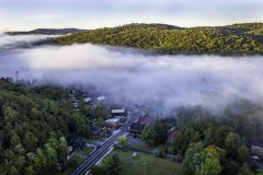 Aerial photo of foggy morning sunrise in Inlet, NY in the Fall