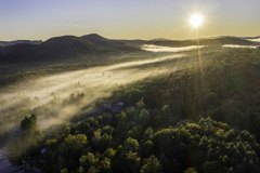 Aerial photo of foggy morning sunrise in Inlet, NY in the Fall 2