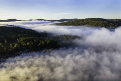 Aerial photo of foggy morning sunrise in Inlet, NY in the Fall 3