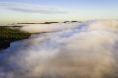 Aerial photo of foggy morning sunrise in Inlet, NY in the Fall over 4th Lake 3