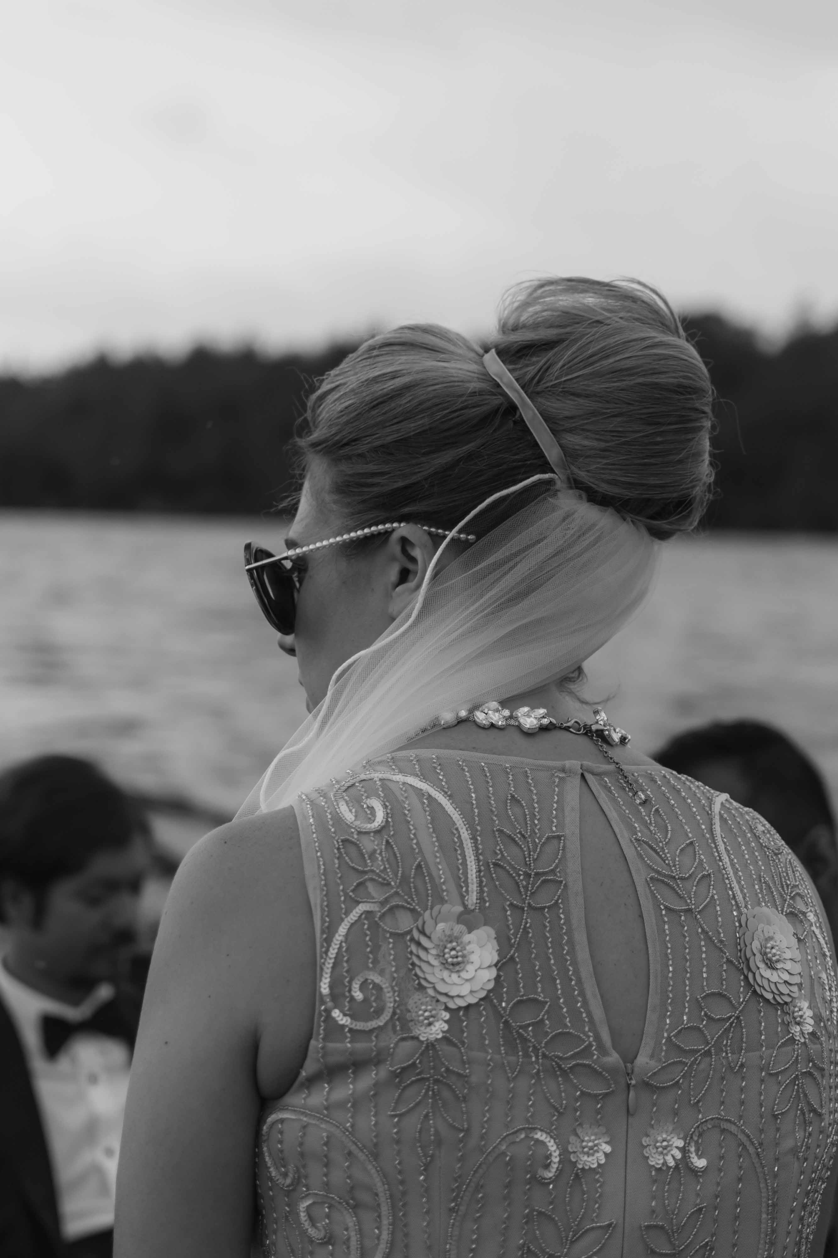 Bride post ceremony wedding pictures on a boat